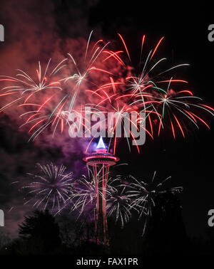 Fireworks display at midnight 2016 Seattle USA Space Needle New Year's day - Stock Photo