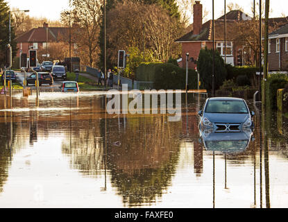 View of a flooded road junction with cars trapped in the flood - Stock Photo