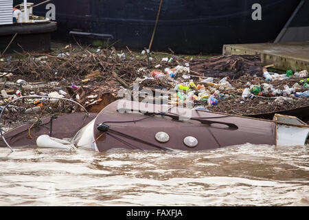 Floods the Aftermath:  rubbish in a river after the floods have receded - Stock Photo