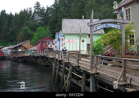 Tourists enjoy a visit to the boardwalk on Creek Street, Ketchikan, Southeast Alaska, summer - Stock Photo