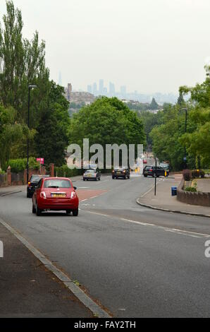 Road downhill with a view towards London city centre, England - Stock Photo