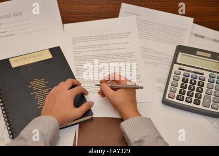 background, boredom, business, businessman, concentration, concern, document, doubt,  fatigue, file, folder, glasses, - Stock Photo