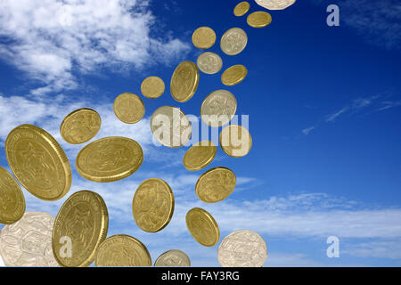 a lot of coins falling from a blue cloudy  sky - Stock Photo