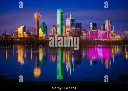 Downtown Dallas, Texas reflecting in the Trinity River - Stock Photo