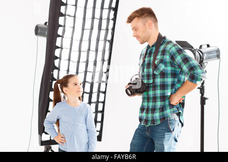 Both photographer and model standing in the same pose. - Stock Photo