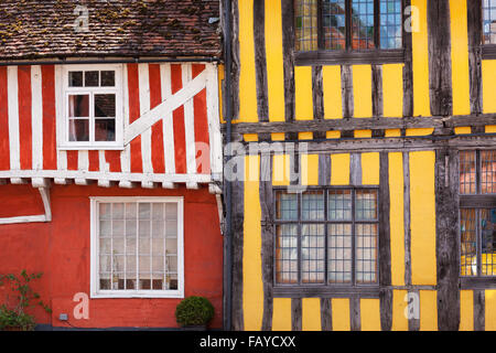 Quaint, colourful and half-timbered houses in an English village; Lavenham, Suffolk, England - Stock Photo