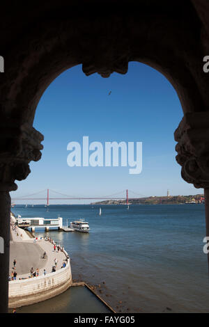 Yacht on the River Tagus seen from a window in the Tower of Belem (Torre de Belem) in the waterfront Belem district - Stock Photo