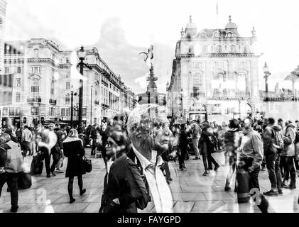 Double Exposure at Piccadilly Circus, London. - Stock Photo