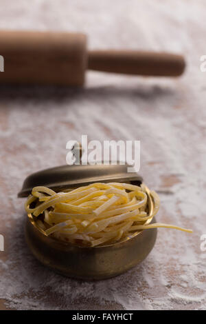 Pasta all'uovo and rolling pin - Stock Photo