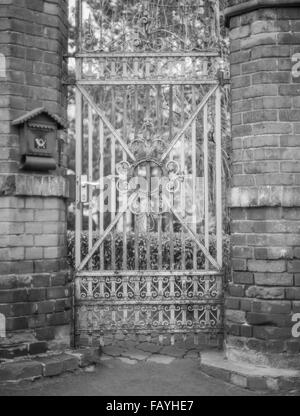Old worn out ornamental iron gate - Stock Photo