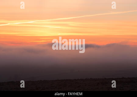 Sunset from the top of stowes hill near the village of Minions on Bodmin Moor - Stock Photo