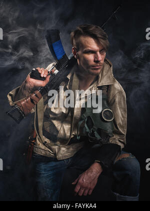 Armed man with a gun. Post-apocalyptic fiction. Stalker. - Stock Photo