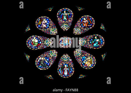 Stained glass rose window with Jesus and twelve disciples ...