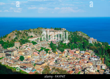 Taormina landscape Sicily, aerial cityscape view of Taormina, showing the auditorium of the ancient Greek theater - Stock Photo