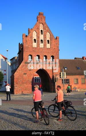 Biker in front of  Wassertor town gate, Wismar, Baltic Sea, Mecklenburg Western Pomerania, Germany, Europe - Stock Photo