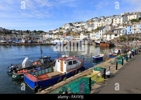 Small fishing boats moored moored at the New Quay, Brixham, Devon, on a glorious summer's day; the town rises in - Stock Photo