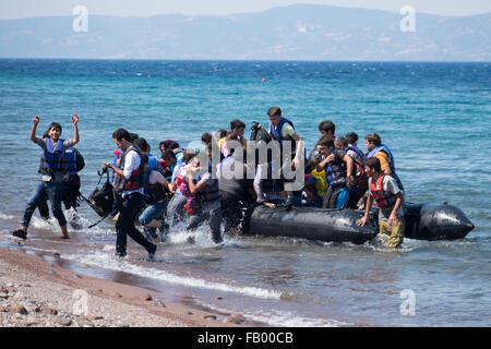 Syrian refugees cross from Turkey to land on a beach on the Greek island of Lesvos. - Stock Photo