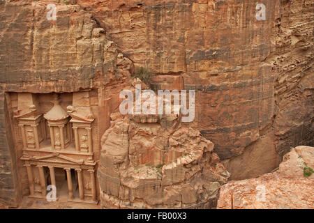 Al Khazneh / The Treasury, carved out of a sandstone rock face in the ancient city of Petra in southern Jordan - Stock Photo
