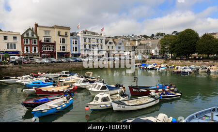 The small, but busy, quay in Dartmouth, Devon, with the Royal Castle Hotel behind, on a partly-cloudy summer's day - Stock Photo