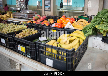 Fresh fruit and vegetables on a market stall in Silves Market Hall, Algarve, Portugal. - Stock Photo