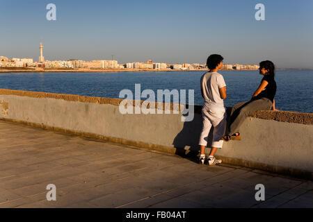 couple in  levee of Campo del Sur. Cádiz, Andalusia, Spain - Stock Photo