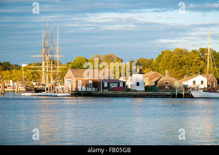 Sun setting by Mystic Seaport, across the river, an outdoor recreated 19th century village and educational maritime - Stock Photo