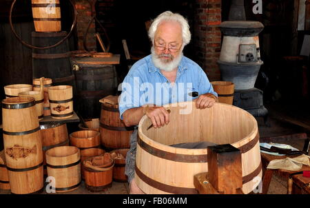 Mystic, Connecticut:  Cooper at work making a wooden barrel in the Cooperage Shop at Mystic Seaport Museum - Stock Photo