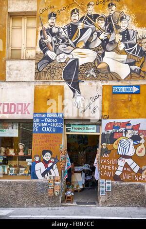 Murales in Orgosolo village, art street wall painting, Nuoro Province, Sardinia, Italy - Stock Photo