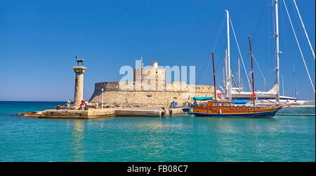 Mandraki harbour and fortress Agios Nicolaos in Rhodes town, Rhodes Island, Greece - Stock Photo