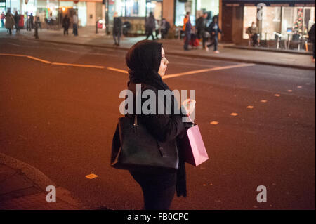 Muslim woman on Edgware Road in London, England. - Stock Photo