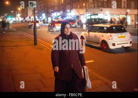 Muslim woman on Edgware Road in London, England. - Stock Photo
