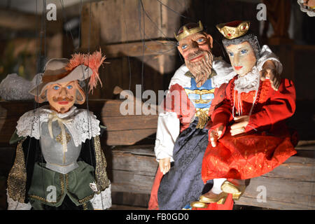 Christmas stringed wooden puppets of Royalty at the Christmas markets in Prague - Stock Photo