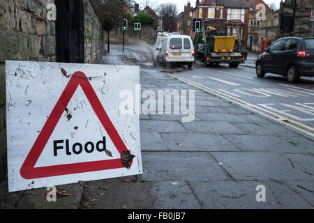 Flood sign on a british road in winter - Stock Photo