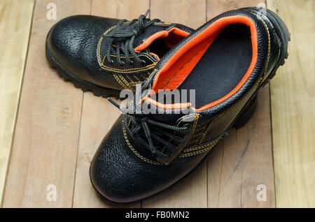 Black Steel Toe Safety of steel cap work boots . - Stock Photo
