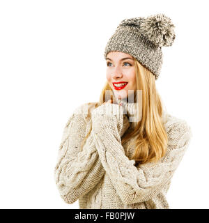 Happy Woman in Winter Sweater and Hat - Stock Photo