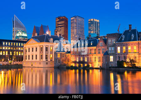 The Dutch Parliament buildings at the Binnenhof from across the Hofvijver pond in The Hague, The Netherlands at - Stock Photo
