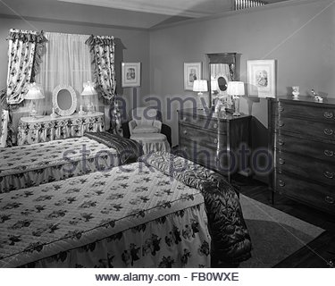 Highway 42 section of Marshall Field and Company furniture department, 1943 Feb. 15. Bedroom with two twin beds. - Stock Photo