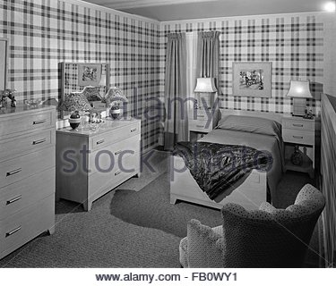 Highway 42 section of Marshall Field and Company furniture department, 1943 Feb. 15. Boys bedroom with plaid wallpaper. - Stock Photo
