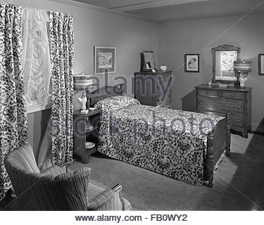 Highway 42 section of Marshall Field and Company furniture department, 1943 Feb. 15. Bedroom with a twin bed. - Stock Photo