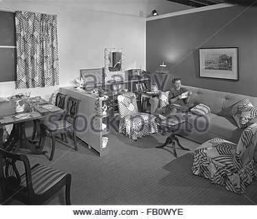 Furniture settings in department stores in Chicago (Ill.), 1943 Feb. 26. Living room and kitchen display setting. - Stock Photo