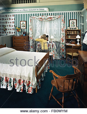 Furniture settings in department stores in Chicago (Ill.), 1943 Feb. 26. Bedroom with girl sitting at her vanity - Stock Photo