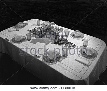 Furniture displays at Marshall Field and Company, 1943 Mar. 19. Dining table with place settings. - Stock Photo