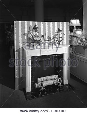 Furniture displays at Marshall Field and Company, 1943 Mar. 19. Fireplace. - Stock Photo