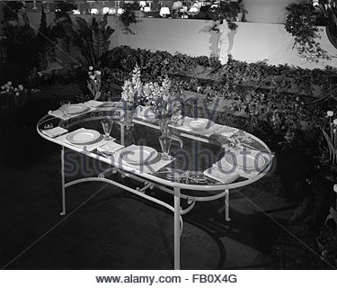 Furniture displays at Marshall Field and Company, 1943 Mar. 19. Display, patio table. - Stock Photo