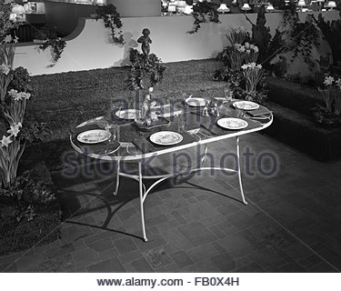 Furniture displays at Marshall Field and Company, 1943 Mar. 19. Patio table with place settings. - Stock Photo