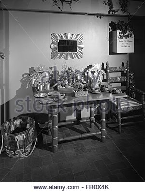 Furniture displays at Marshall Field and Company, 1943 Mar. 19. Table with home furnishings. - Stock Photo