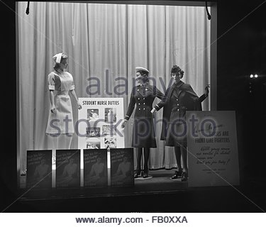 Window displays at Marshall Field and Company, including Navy women, 1943. Student nurse. - Stock Photo
