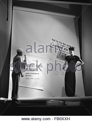 Window displays at Marshall Field and Company, with Black Magic theme, 1943 May 29. Lounging apparel. - Stock Photo