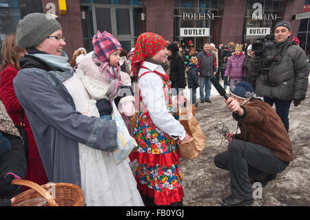 Young women welcoming Three Wise Men with trinkets, Epiphany (Three Kings) Holiday procession in Wroclaw, Lower - Stock Photo