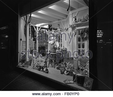 Window displays at Marshall Field and Company with toys, 1943 Dec. 2. Toys, Santa's Workshop. - Stock Photo